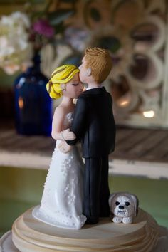 A serene, cute cake topper with extra sweetness from that little dog looking on! #wedding #caketopper