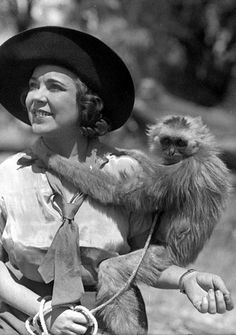 Osa Johnson, American adventurer and documentary filmmaker, with one of her pet monkeys in Africa, ca. 1930s. (source)