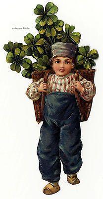 Vintage Victorian die cut paper scrap, Boy carrying lucky clover, c. 1880