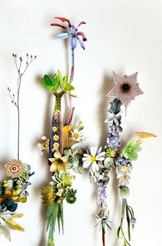 Beautiful display of plants.   - http://eclectictrends.com/flower-constructions-by-anne-tenn-donkelaar/