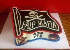 A FAIP Mafia Fini Flight Cake! Chocolate cake with vanilla buttercream. MMF accents and two hand painted squadron patches finish the look.  #FAIPmafia