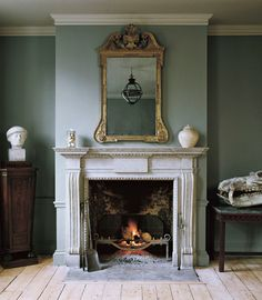 ~Jamb - The Chesham chimneypiece in distressed Portland stone with the Arts and Crafts fire basket and Stockton fire irons. A small Original Globe is reflected in the mirror. Vintage Fireplace, Victorian Fireplace, Home Fireplace, Living Room With Fireplace, Fireplace Surrounds, Fireplace Design, Antique Fireplace Mantels, Fireplace Ideas, Antique Mantel