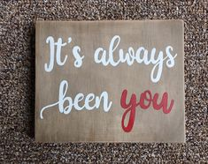 This is perfect for any occasion to tell your loved one how much they mean to you! This sign is made from lightweight reclaimed wood and is stained with a handmade natural stain that has a grayish brown hue. The lettering is painted with acrylic white and red paint and is slightly
