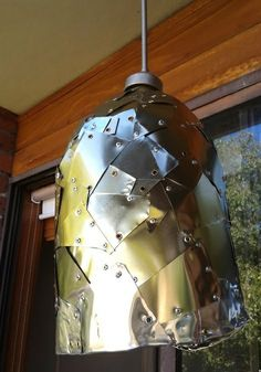 a campana style lamp made of recycled aluminium cans