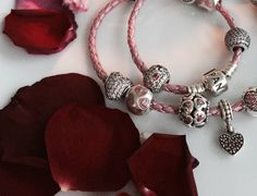 Rose pedals and pink leather bracelet #PANDORAbracelet #hearts #pink #cute for Valentine