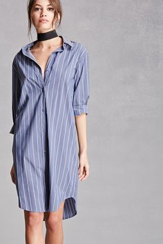 A woven oversized shirt dress featuring a pinstripe print, a buttoned front closure, a basic collar, long sleeves with buttoned cuffs, and a curved hem. This is an independent brand and not a Forever 21 branded item.