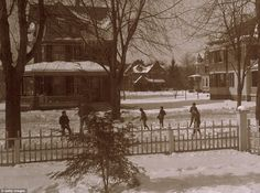 Snowy New York: Warmly wrapped up children play in front of Dewitt Church, 280 Rivington Street, in 1890