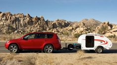 Little Guy 5-Wide Platform Model Teardrop Camper Trailer has the Classic teardrop shape. This camper trailer sports a fiberglass exterior with custom graphics. Locking double entry doors with slider window and screen provide safety and privacy, and a rear locking hatch provides access to the galley. Queen Sized Bed.   Towing Capacity is  a Prius!