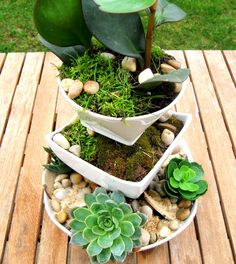 Create a tiered plant stand with old dishes