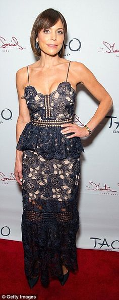 Strike a pose: Bethenny's floor-length look featured a peplum waist and frilly skirt...