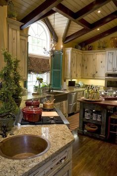 I know this is the kitchen, but I love this ceiling idea for the porch. ~Eye For Design: Decorating Tudor Style