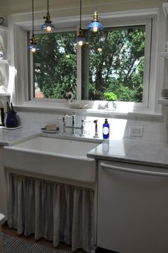 Blue pendant lights over skirted farmhouse sink.  Gorgeous huge window and white appliances.  So pretty!!  White Kitchen Transformation in Upstate New York