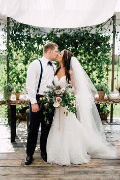 bride and groom - http://ruffledblog.com/chic-niagara-on-the-lake-vineyard-wedding photo Simply Lace