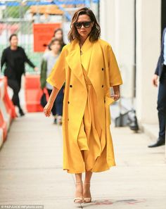 Duster diva! Victoria Beckham was as welcome as the sunshine in a sensational monochromatic ensemble in Manhattan's Chelsea neighborhood on Thursday