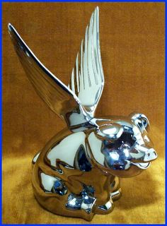 Flying pig hood ornament..  Where have you been all my life Little Piggy?!?