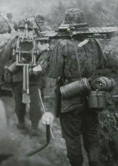 Soldiers carrying MG 37(t). The ZB-53, aka mg 27(t) in german service, was a Czechoslovak machine gun.