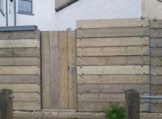 Love this fence and gate made with recycled scaffolding planks.