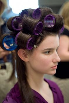 Simple Steps To The Modern-Day Bouffant: 2.-Starting at the top of the scalp, wrap one-inch sections of hair around Velcro rollers and secure with hair clips.