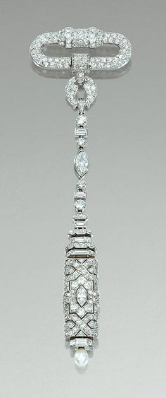 CULTURED PEARL AND DIAMOND FOB WATCH, VAN CLEEF & ARPELS, 1920s.      Designed as an articulated line of variously shaped diamonds, suspending a rectangular-shaped watch similarly set, with a pierced decoration of geometric design, the reverse inset with a square dial applied with Arabic numerals, to a cultured pearl winder, mounted in platinum,    signed Van Cleef & Arpels and numbered, French assay marks.
