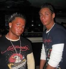 Hmm Ed Hardy and spray tan overkill=Douche Bag