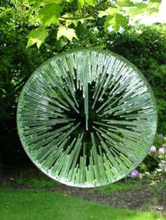Mirrored stainless steel. float glass. Garden sculpture by artist Jane Bohane titled: 'Shattered Lens (glass garden sculptures)'