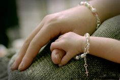 thatgirlinpearls:  My daughter, Ava, has a very similar bracelet except in gold which she got as a baptism got from her Godmother  Godfather. :)