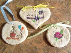 Salt clay tags. 1 c. salt, 2 cups flour, 1 cup warm water. Roll, cut with cookie cutters, make hole with tooth pick, stamp with stamp and ink, bake 2 hrs @ 250. Paint, add ribbon.