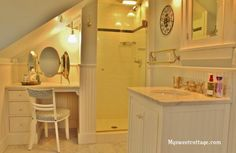 A bathroom in a dormer window, 1920s cottage remodel using carrera marble, My Sweet Cottage featured on @Remodelaholic