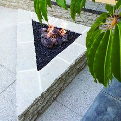 Triangular firepit      This unusually-shaped firepit is the perfect fit in a small corner of a backyard- 38 ideas for firepits | Triangular firepit   | Sunset.com