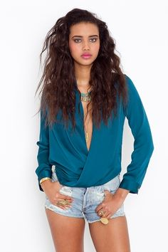 thinking this teal top.. with red shorts!