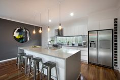 Polar White cabinets Caesarstone Oyster benchtops Dulux Lexicon on the walls and glass splashback Dulux Raku feature wall
