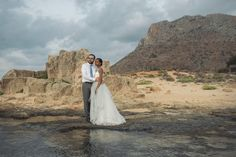 Soft elopement on the beach in Crete | Crete for Love This beach location in Chania area is our of this world! Look at those wild mountains touching a rough coastal line with crystal blue waters