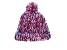 Keep warm in style! Perfect for winter sports, or watching the game, this handknit hat has a folded brim, pom-pom, and is done in three