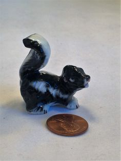 Old collectible skunk vintage ceramic miniature animal small sculpture diarama woodland knick knack animal figurine by MarveltyVintage on Etsy