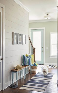 beach house foyer with shiplap walls