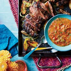 What makes this grilled steak-and-potato dish special is the delicious chimichurri, which gets rich, sweet flavor from roasted tomatoes.