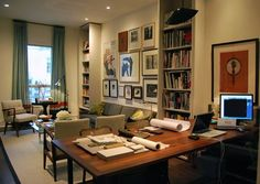 love the layout of office and living room combo plus an attractive gallery wall
