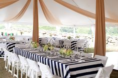 Striped table cloths for a Martha's Vineyard wedding. Photo: Jocelyn Filley
