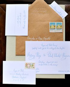 A blue calligraphed Parrott Design Studio invitation is stuffed into a kraft-paper envelope for an organic feel.