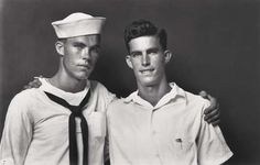 MICHAEL DISFARMER - 1940s. This photograph was probably taken to mark the departure of the sailor brother. A touching contrast in expressions.