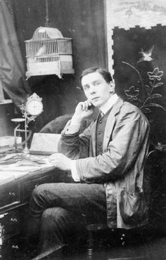 Portrait of the First World War correspondent and official cinematographer, Geoffrey Malins seated at a desk. This image was probably taken during his early career as a portrait photographer before 1910. © IWM