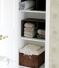 baskets turned on sides for linen closet organization