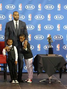 Miami Heat guard LeBron James stands along with his sons, Bryce James, left, and LeBron James Jr, next to his MVP trophy on Sunday, May 5, 2013 during the ceremony at the AmericanAirlines Arena. HECTOR GABINO / EL NUEVO HERALD STAFF Read more here: http://www.miamiherald.com/2013/05/05/3381843/james-wins-mvp-1-vote-shy-of-unanimously.html#storylink=cpy