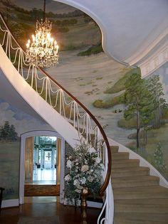 Beautiful winding staircase with 'draped iron' balustrade, & full wall mural...