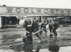 Fire guts part of Golden Mile plaza. Three of the 50 firefighters called out yesterday to battle a spectacular fire that gutted the west end of Scarborugh's Golden Mile Plaza roll up their hoses after finally dousing the last ember. The mall, built mostly Scarborough Ontario, Toronto Star, Wood Photo, West End, Photo Archive, Firefighter, Mall, 1950s, Battle