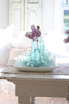 Blue glass for shabby chic love! Living room Whitewashed Cottage chippy shabby chic french country rustic swedish decor idea.  ***Pinned by oldattic ***.