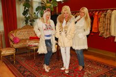 2 white shearling coats and mink coat with lynx collar.
