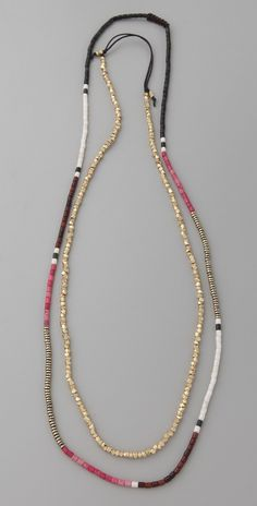 Shashi Zen Golden Nugget Necklace: i like the color block strand balanced by the solid metal strand