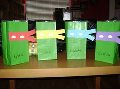 TMNT Grab Bags. Made with green craft bags & construction paper. Inside: TMNT comic book, crayons, coloring sheets, & TMNT candy. Less than $3 per kid