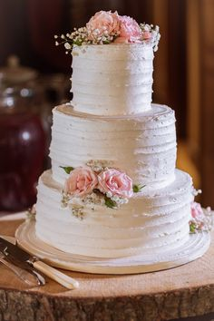 A three-tier pink rose and white baby's breath adorned wedding cake. Willow Springs Winery Summer Wedding, Stouffville, Ontario: Hilary & Kevin, July 4, 2015